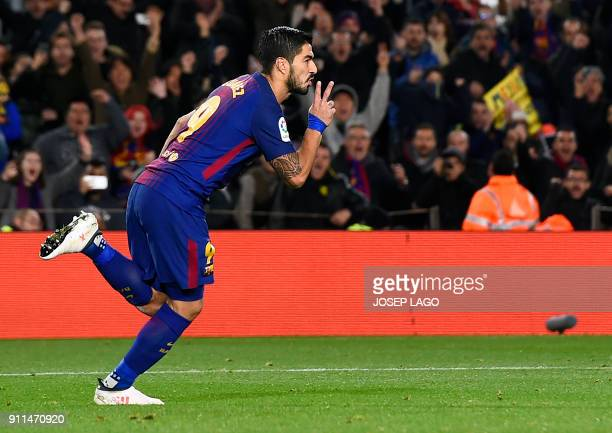 Barcelona's Uruguayan forward Luis Suarez celebrates a goal during the Spanish league football match between FC Barcelona and Deportivo Alaves at the...