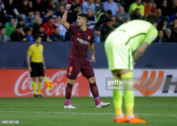 Barcelona's Uruguayan forward Luis Suarez celebrates a goal during the Spanish league football match between Malaga CF and FC Barcelona at the La...