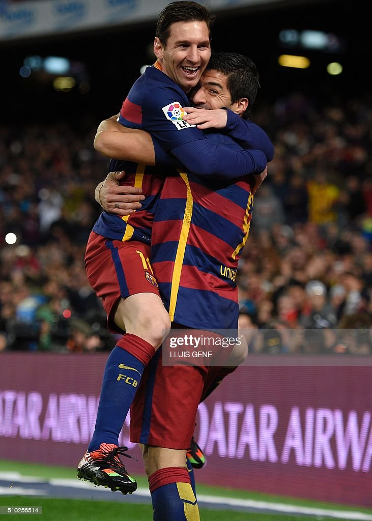 Barcelona's Uruguayan forward Luis Suarez (R) celebrates a goal with Barcelona's Argentinian forward Lionel Messi during the Spanish league football match FC Barcelona vs RC Celta de Vigo at the Camp Nou stadium in Barcelona on February 14, 2016. GENE
