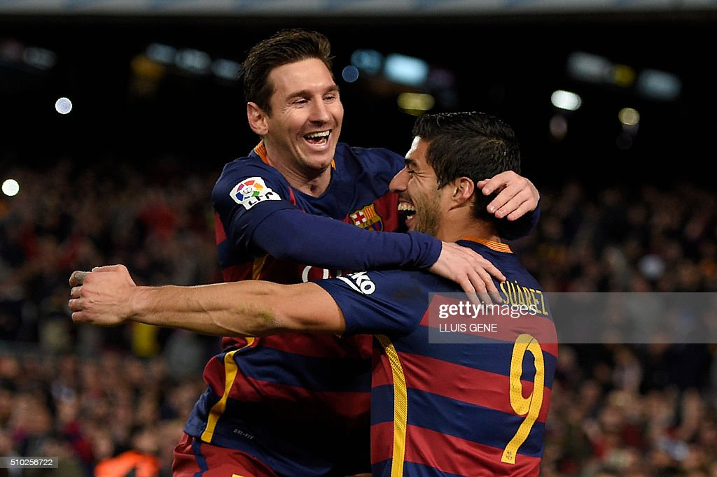 TOPSHOT - Barcelona's Uruguayan forward Luis Suarez (R) celebrates a goal with Barcelona's Argentinian forward Lionel Messi during the Spanish league football match FC Barcelona vs RC Celta de Vigo at the Camp Nou stadium in Barcelona on February 14, 2016. GENE