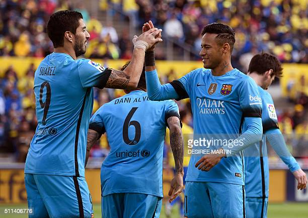 Barcelona's Uruguayan forward Luis Suarez celebrates a goal with Barcelona's Brazilian forward Neymar during the Spanish league football match UD Las...