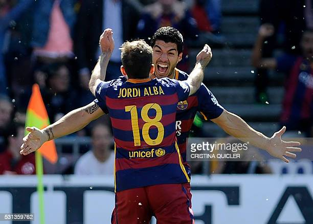 TOPSHOT Barcelona's Uruguayan forward Luis Suarez celebrates a goal with Barcelona's defender Jordi Alba during the Spanish league football match...
