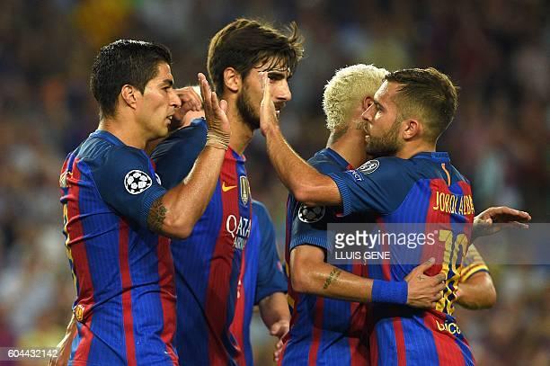 Barcelona's Uruguayan forward Luis Suarez celebrates a goal with Barcelona's defender Jordi Alba and Barcelona's Portuguesse midfielder Andre Gomes...