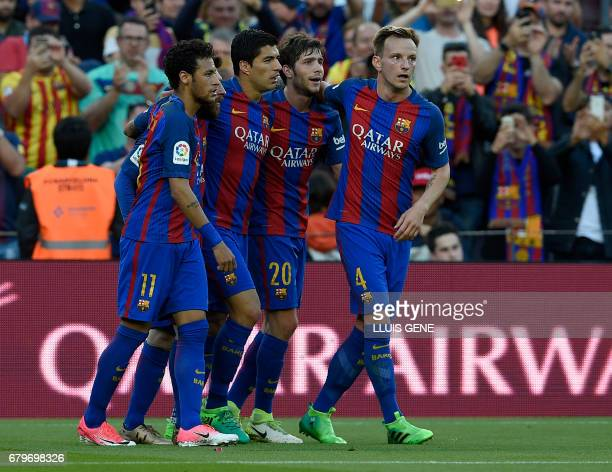 TOPSHOT Barcelona's Uruguayan forward Luis Suarez celebrates a goal with Barcelona's Brazilian forward Neymar Barcelona's midfielder Sergi Roberto...
