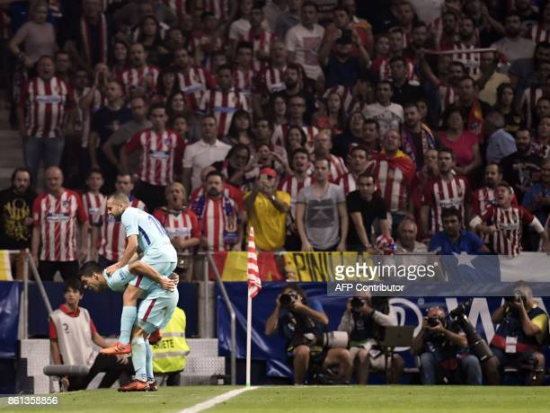 Barcelona's Uruguayan forward Luis Suarez celebrates a goal with Barcelona's Spanish defender Jordi Alba during the Spanish league football match...