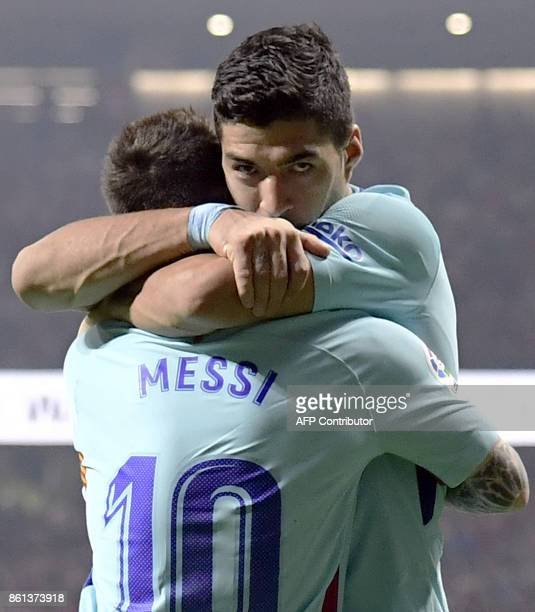Barcelona's Uruguayan forward Luis Suarez celebrates a goal with Barcelona's Argentinian forward Lionel Messi during the Spanish league football...