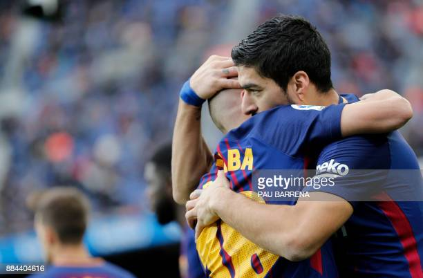 Barcelona's Uruguayan forward Luis Suarez celebrates a goal with Barcelona's Spanish defender Jordi Alba during the Spanish league football match FC...