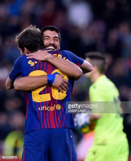 Barcelona's Uruguayan forward Luis Suarez celebrates a goal with Barcelona's Spanish midfielder Sergi Roberto during the Spanish league football...