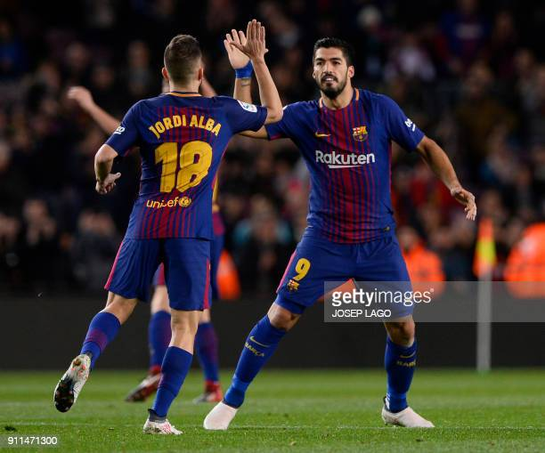 Barcelona's Uruguayan forward Luis Suarez celebrates a goal with Barcelona's Spanish defender Jordi Alba during the Spanish league football match...