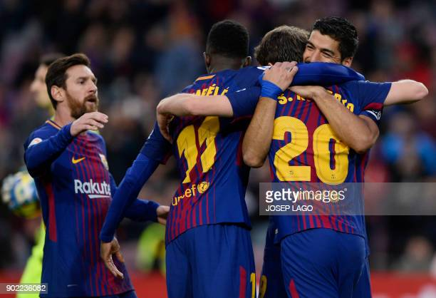Barcelona's Uruguayan forward Luis Suarez celebrates a goal with teammates during the Spanish league football match FC Barcelona vs Levante UD at the...