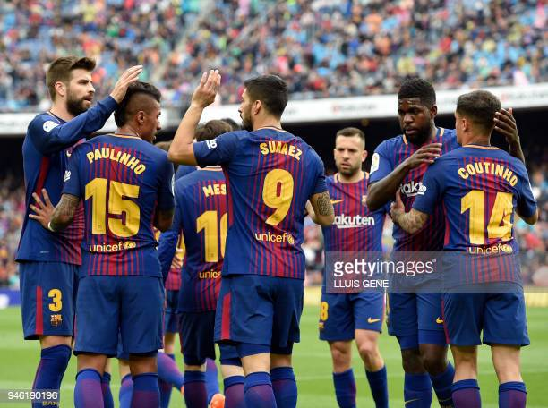 Barcelona's Uruguayan forward Luis Suarez celebrates a goal with teammates during the Spanish league footbal match between FC Barcelona and Valencia...