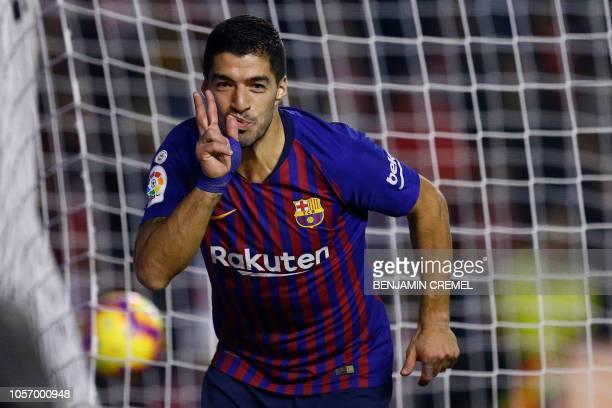 TOPSHOT Barcelona's Uruguayan forward Luis Suarez celebrates after scoring a goal during the Spanish league football match between Rayo Vallecano de...