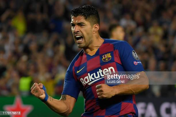 Barcelona's Uruguayan forward Luis Suarez celebrates after scoring a goal during the UEFA Champions League Group F football match between Barcelona...
