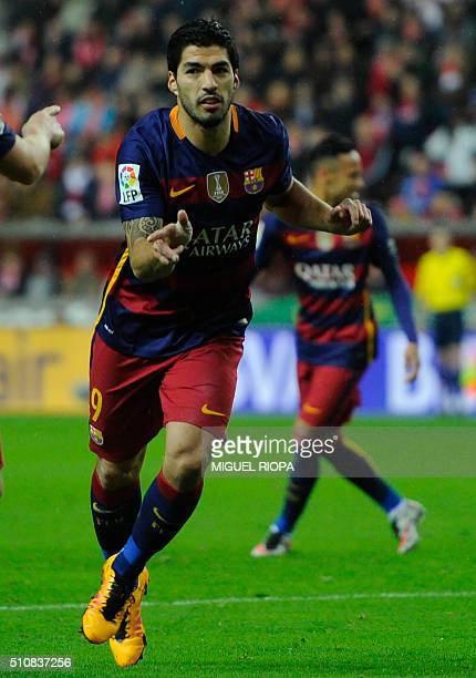 Barcelona's Uruguayan forward Luis Suarez celebrates after scoring a goal during the Spanish league football match Real Sporting de Gijon vs FC...