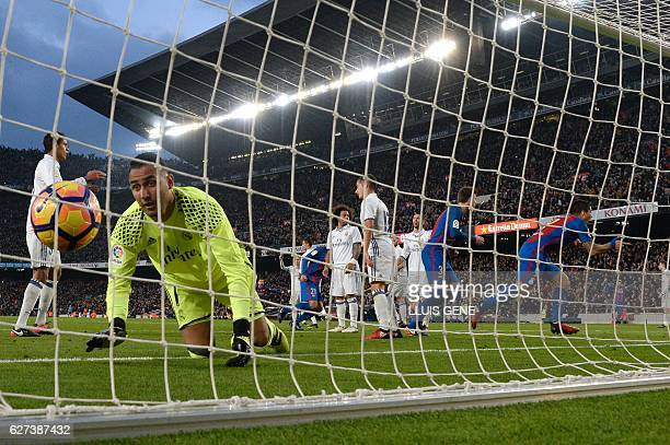 Barcelona's Uruguayan forward Luis Suarez celebrates after scoring a goal during the Spanish league football match FC Barcelona vs Real Madrid CF at...
