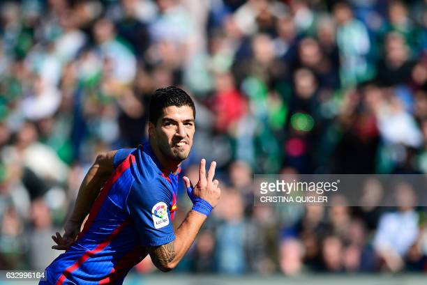 Barcelona's Uruguayan forward Luis Suarez celebrates after scoring a goal during the Spanish league football match Real Betis vs FC Barcelona at the...