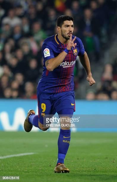 Barcelona's Uruguayan forward Luis Suarez celebrates after scoring a goal during the Spanish league football match between Real Betis and FC...