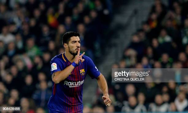 Barcelona's Uruguayan forward Luis Suarez celebrates after scoring a goal during the Spanish league football match between Real Betis and FC...