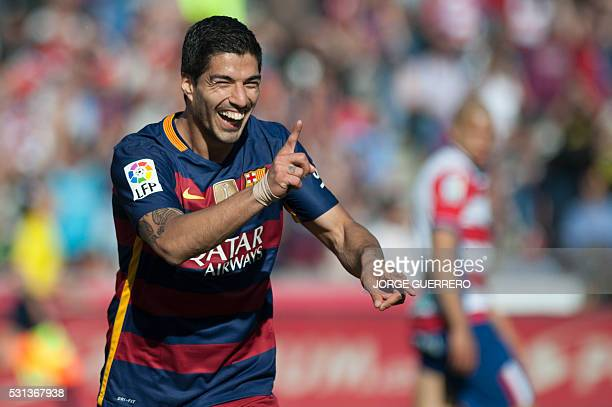 Barcelona's Uruguayan forward Luis Suarez celebrates after scoring his third goal during the Spanish league football match Granada CF vs FC Barcelona...