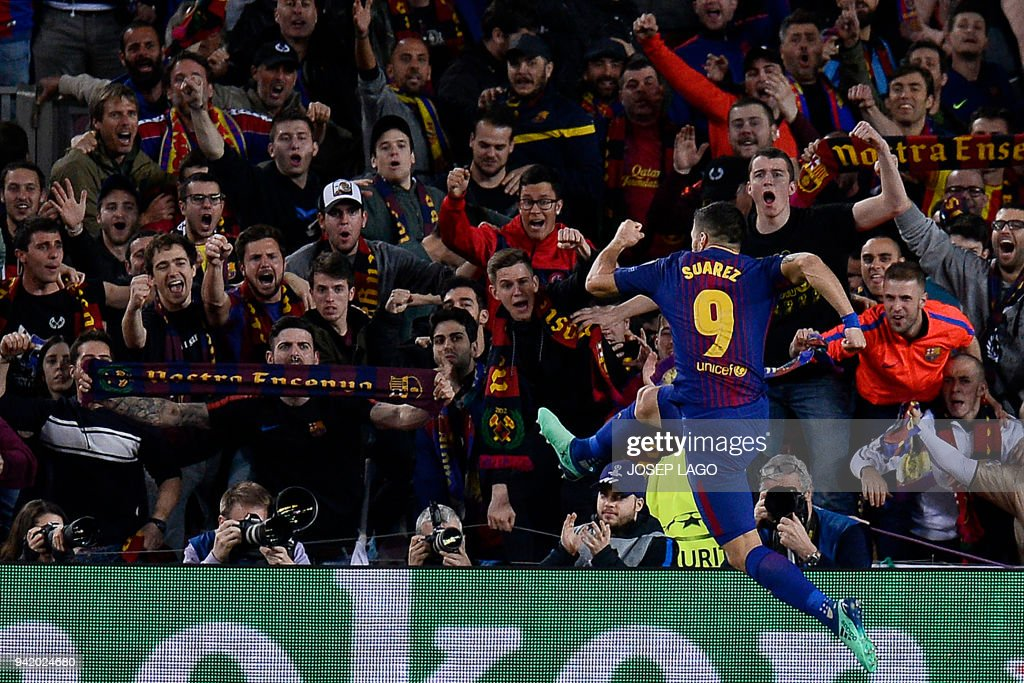 TOPSHOT - Barcelona's Uruguayan forward Luis Suarez celebrates after scoring his team's fourth goal during the UEFA Champions League quarter-final first leg football match between Barcelona and AS Roma at the Camp Nou Stadium in Barcelona on April 4, 2018. / AFP PHOTO / Josep LAGO