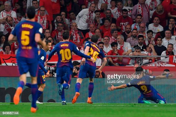Barcelona's Uruguayan forward Luis Suarez celebrates after scoring his second goal during the Spanish Copa del Rey final football match Sevilla FC...