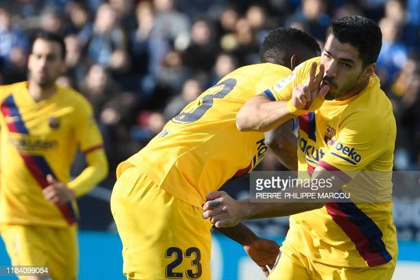 Barcelona's Uruguayan forward Luis Suarez celebrates after scoring during the Spanish league football match Club Deportivo Leganes SAD against FC...
