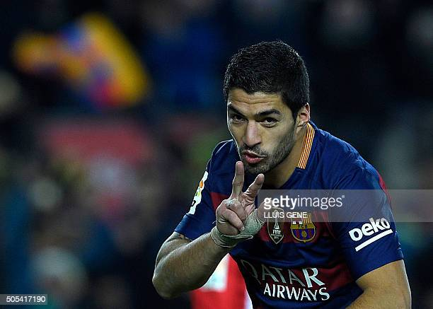 Barcelona's Uruguayan forward Luis Suarez celebrates after scoring during the Spanish league football match FC Barcelona vs Athletic Club Bilbao at...
