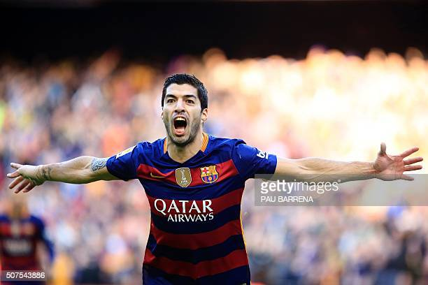 TOPSHOT Barcelona's Uruguayan forward Luis Suarez celebrates after scoring during the Spanish league football match FC Barcelona vs Club Atletico de...