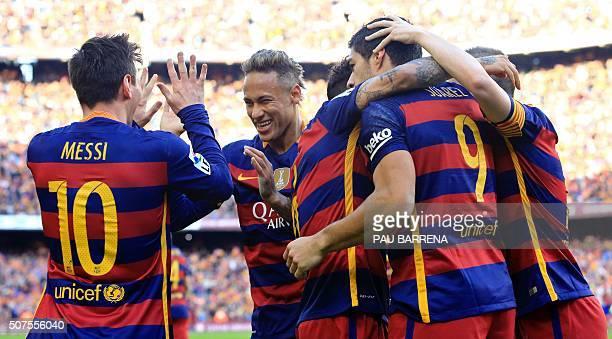 Barcelona's Uruguayan forward Luis Suarez celebrates after scoring past Barcelona's Argentinian forward Lionel Messi and Barcelona's Brazilian...