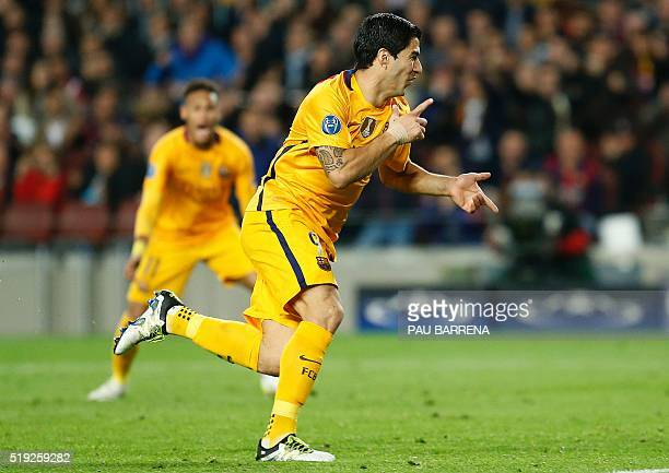 Barcelona's Uruguayan forward Luis Suarez celebrates after scoring during the UEFA Champions League quarter finals first leg football match FC...