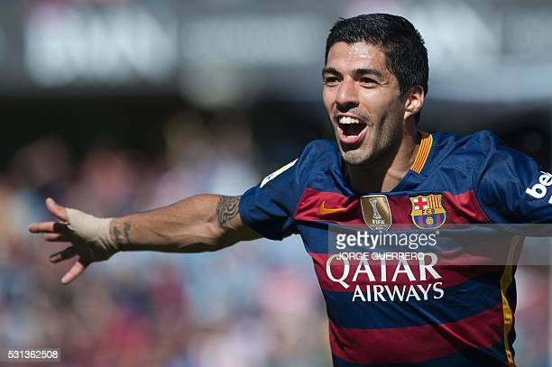 Barcelona's Uruguayan forward Luis Suarez celebrates after scoring during the Spanish league football match Granada CF vs FC Barcelona at Nuevo Los...