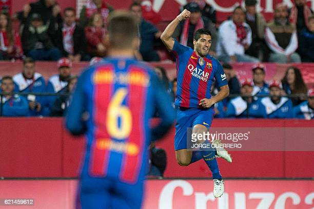 Barcelona's Uruguayan forward Luis Suarez celebrates after scoring during the Spanish league football match Sevilla FC vs FC Barcelona at the Ramon...