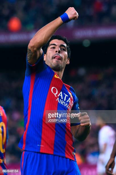 Barcelona's Uruguayan forward Luis Suarez celebrates after scoring during the Spanish league football match FC Barcelona vs Sevilla FC at the Camp...