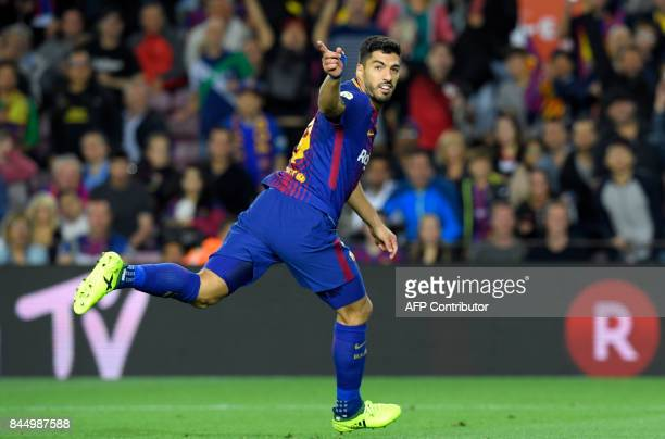 TOPSHOT Barcelona's Uruguayan forward Luis Suarez celebrates after scoring during the Spanish Liga football match Barcelona vs Espanyol at the Camp...