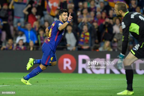 Barcelona's Uruguayan forward Luis Suarez celebrates after scoring against Espanyol's goalkeeper Pau Lopez during the Spanish Liga football match...