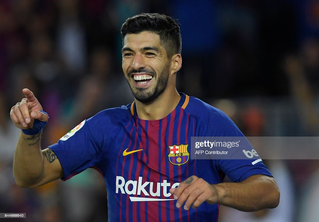 Barcelona's Uruguayan forward Luis Suarez celebrates after scoring during the Spanish Liga football match Barcelona vs Espanyol at the Camp Nou stadium in Barcelona on September 9, 2017. /