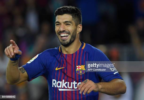 Barcelona's Uruguayan forward Luis Suarez celebrates after scoring during the Spanish Liga football match Barcelona vs Espanyol at the Camp Nou...