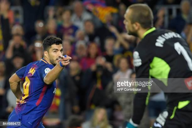 TOPSHOT Barcelona's Uruguayan forward Luis Suarez celebrates after scoring against Espanyol's goalkeeper Pau Lopez during the Spanish Liga football...