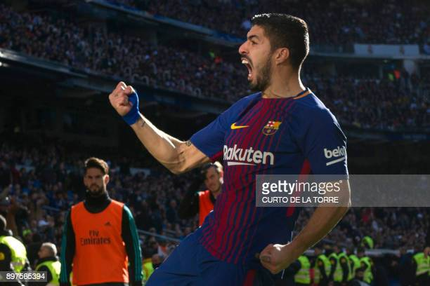Barcelona's Uruguayan forward Luis Suarez celebrates after scoring during the Spanish League Clasico football match Real Madrid CF vs FC Barcelona at...