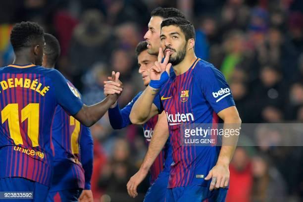 Barcelona's Uruguayan forward Luis Suarez celebrates after scoring during the Spanish league football match between FC Barcelona and Girona FC at the...
