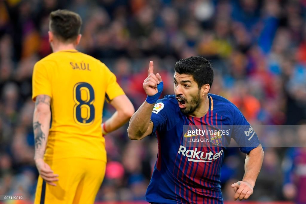 Barcelona's Uruguayan forward Luis Suarez celebrates after scoring during the Spanish league football match FC Barcelona against Club Atletico de Madrid at the Camp Nou stadium in Barcelona on March 04, 2018. Suarez´s goal was annulled. /