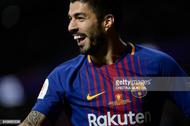Barcelona's Uruguayan forward Luis Suarez celebrates after scoring during the Spanish Copa del Rey final football match Sevilla FC against FC...