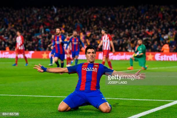 TOPSHOT Barcelona's Uruguayan forward Luis Suarez celebrates after scoring the opener during the Spanish Copa del Rey semi final second leg football...