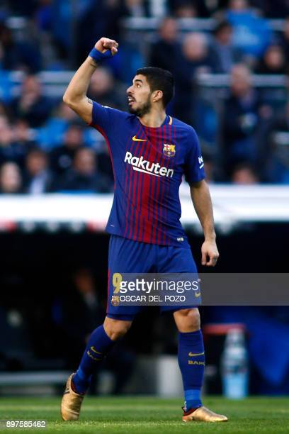 Barcelona's Uruguayan forward Luis Suarez celebrates during the Spanish League 'Clasico' football match Real Madrid CF vs FC Barcelona at the...