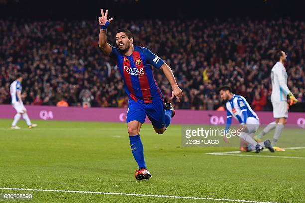 Barcelona's Uruguayan forward Luis Suarez celebrates his goal during the Spanish league football match FC Barcelona vs RCD Espanyol at the Camp Nou...