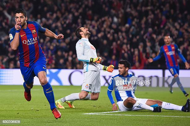 TOPSHOT Barcelona's Uruguayan forward Luis Suarez celebrates his goal during the Spanish league football match FC Barcelona vs RCD Espanyol at the...