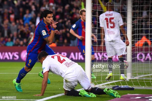 Barcelona's Uruguayan forward Luis Suarez celebrates his goal during the Spanish league football match FC Barcelona vs Sevilla FC at the Camp Nou...