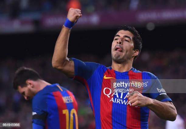 Barcelona's Uruguayan forward Luis Suarez celebrates his goal during the Spanish league football match FC Barcelona vs Sevilla FC at the Camp Nou...