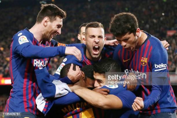 TOPSHOT Barcelona's Uruguayan forward Luis Suarez celebrates his goal with teammates during the Spanish league football match between FC Barcelona...