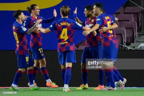 Barcelona's Uruguayan forward Luis Suarez celebrates his goal with teammates during the Spanish League football match between Barcelona and Espanyol...